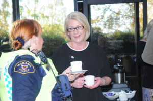 Senior Constable Sharee Smith (pictured in uniform) and Inspector Philippa Burk share conversation over a cup of tea at the 100 years Women In Policing High Tea on Saturday 3 June 2017.