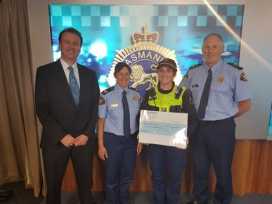 Edmund Rice Camp Cheque Presentation by Constable Aletia Kube to Andrew Blackett CEO