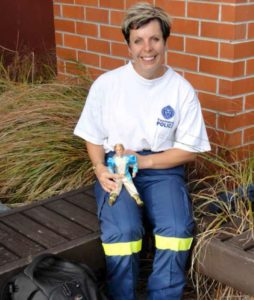 Constable Tanya Curtis with the 'Ken' doll mascot used for DVI training