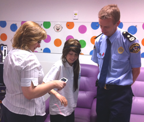Photograph of vein illumination device, purchased by the Royal Hobart Hospital with $5,000 donation from the Trust. Pictured are Clinical Nurse Consultant Helen Starosta, patient Rose, and Commissioner Darren Hine.