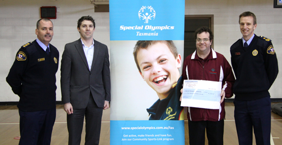 Special Olympics Tasmania cheque handover from Tasmania Police Charity Trust Quiz Night 2013