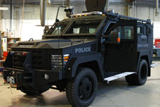 Armoured Police Vehicle parked inside garage.